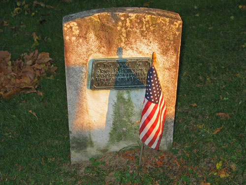 "This hard-to-find marker, with a plaque that reads ""The Grave of John J. Peterson, Revolutionary War, Westchester Militia (1746 – 1850)"" is the grave of a little-known African American soldier, who played a small but crucial role in a pivotal event of the war. On September 21, 1780, Peterson, along with Moses Sherwood, brought a cannon from Fort Lafayette at Verplanck's Point to Croton Point. There they fired on the British frigate ""Vulture"" which was waiting to pick up Major John André, who at the time was plotting with American General Benedict Arnold for the surrender of West Point. The Vulture abandoned its river position, forcing the spy André to move overland on horseback. He was captured in Tarrytown a few days later carrying plans of West Point. André was hanged in the tiny Rockland County hamlet of Tappan on October 2, 1780. Today, the cannon used by the patriots sits in front of the Peekskill Museum. Sherwood is buried in Ossining's Sparta Cemetery"