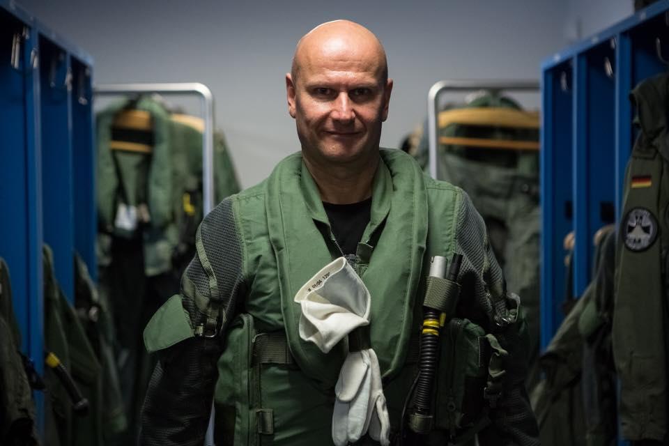 Sascha in full jetfighter pilot uniform.