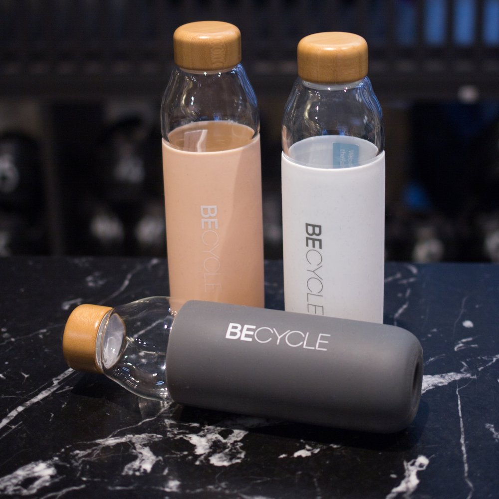 ECO-FRIENDLY HYDRATION - Say goodbye to plastic and hello to chic glass bottles that keep your water as cool as they look. BECYCLE bottle, from 35€Image: mason noteboom