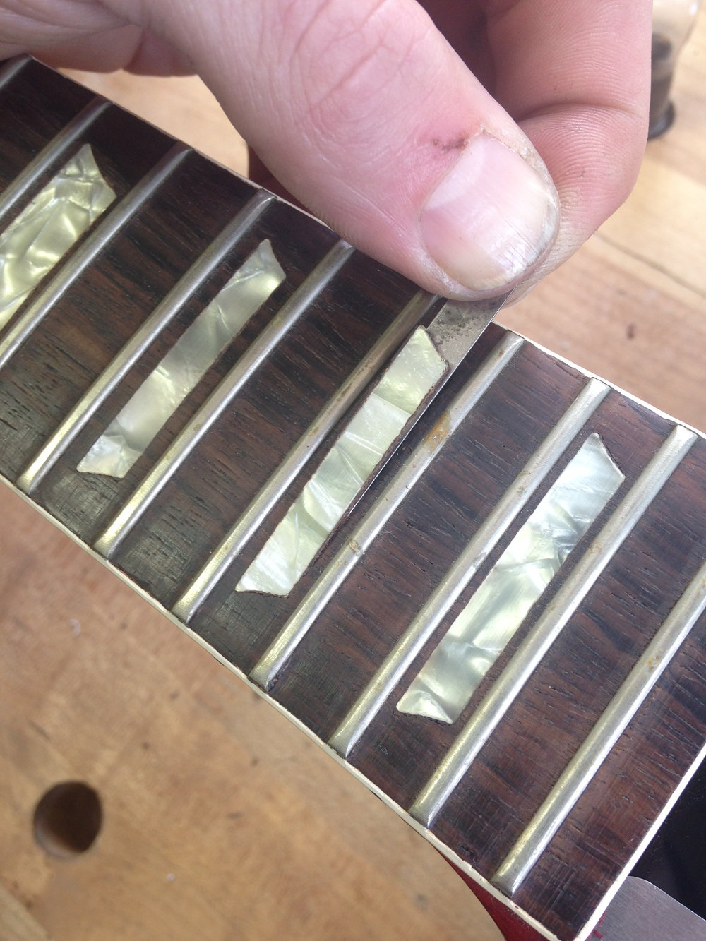- I chose to remove the inlays. This guitar was made in the 60s and the inlays are made of celluloid instead of pearl. The heat that I am about to apply would damage them.