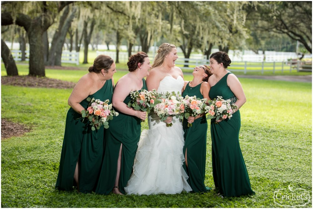 Bride and her bridesmaids holding bouquets