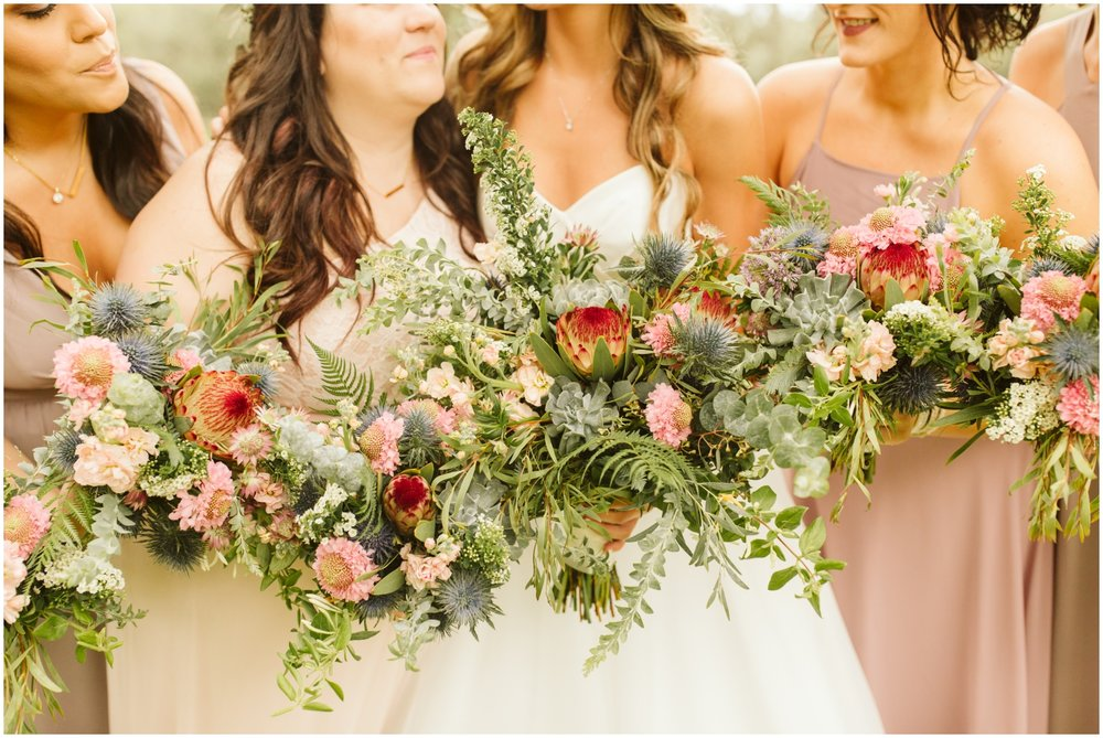 Bridesmaids and bride greenery wedding bouquets