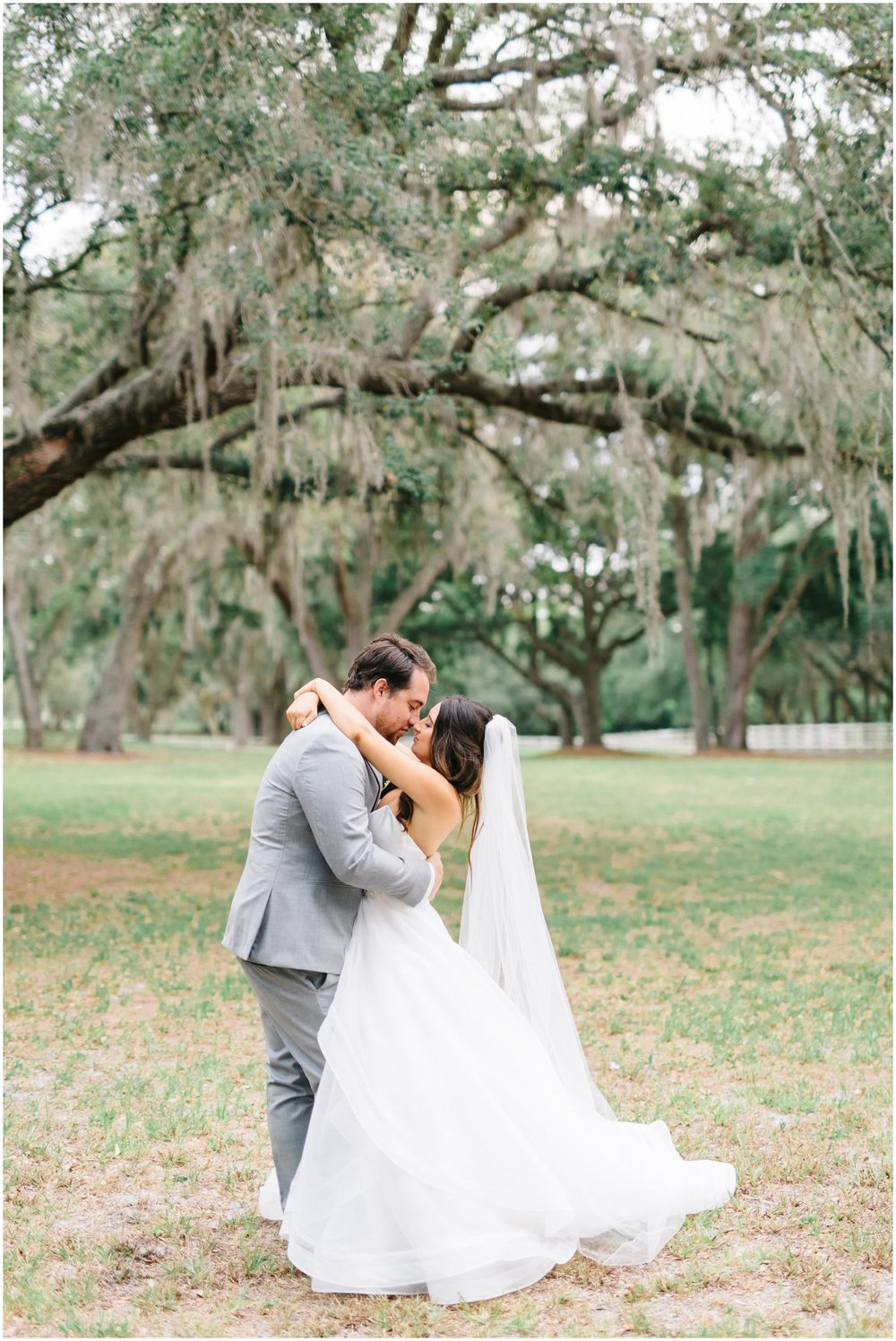 Bride and groom kiss at their Florida wedding