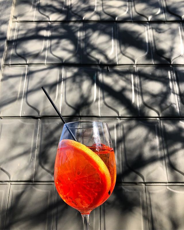 Warm weather calls for a refreshing spritz 😎 Stop by today from noon to 10 and try the A-Glow, a house riff on an Aperol Spritz