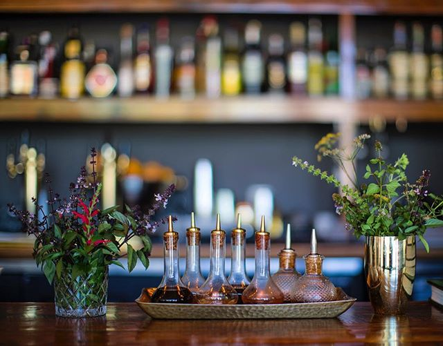 #tbt to when the bar was full of vibrant herbs to add as a fresh garnish to your cocktails! The 🌞 is working it's magic and getting us ready to make the bar look like this again. 🙋♀️ Who else is ready?? 🙋♂️ // 📸 by: @mollympetersonphotographer
