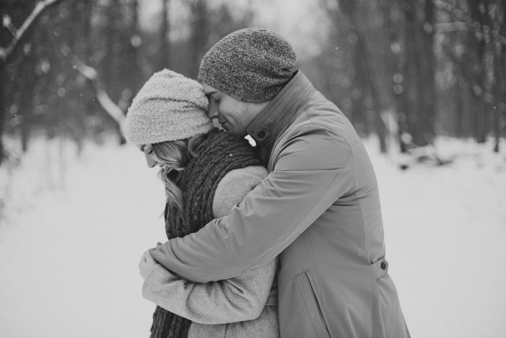 Kurtis and Ann Cuddle Snow BW.jpg