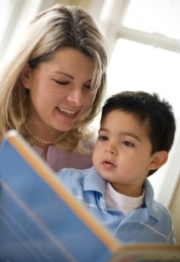 Mom and son reading; learn to read, decoding and rerading problems treated at Canto Speech Therapy Online