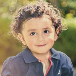 Little boy looking and thinking; language development at Canto Speech Therapy Online