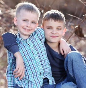 Two boys with arm around shoulders developing social communication at Canto Speech Therapy Online