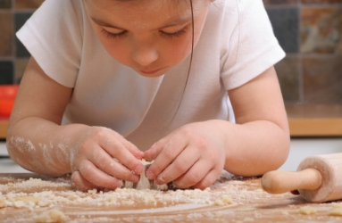 Girl making play dough; language activities at Canto Speech Therapy Online