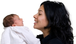Mom talking to new born baby; language development at Canto Speech Thwerapy Online