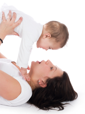 Mom holding up baby, yalking; language development at Canto Speech Therapy Online