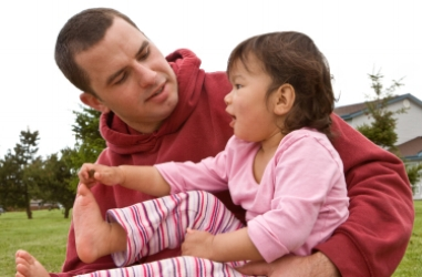 Dad talking with 12 month old baby; speech development at Canto Speech Therapy Online