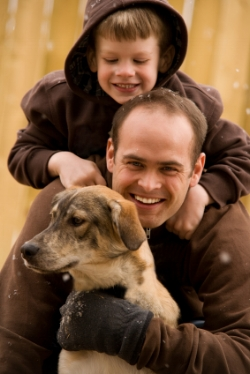 Dad with boy and dog, talking; language development at Canto Speech Therapy Online