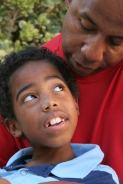 Dad and son; treat language processing disorder at Canto Speech Therapy Online