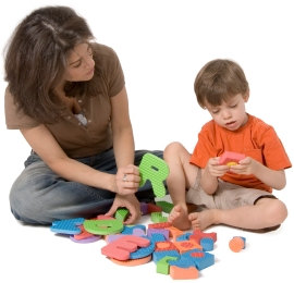 Mom teaching boy letters; alphabet knowledge, a pre-reading skill, helps reading success at Canto Speech Therapy Online