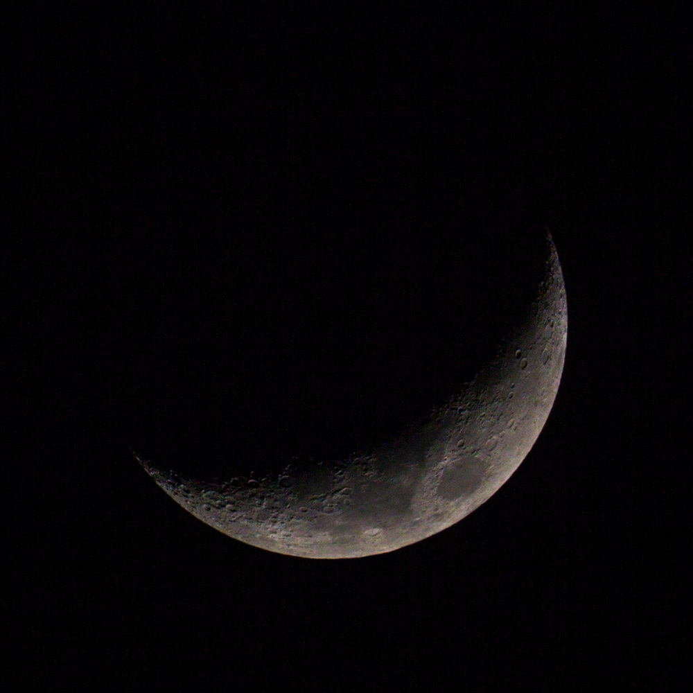 My first moon photo I felt I could share with friends. Taken with the most common cited exposure settings found online: 1/125th sec, f/11, ISO 100, 200+mm lens, manual focus, tripod, 2 sec timer.