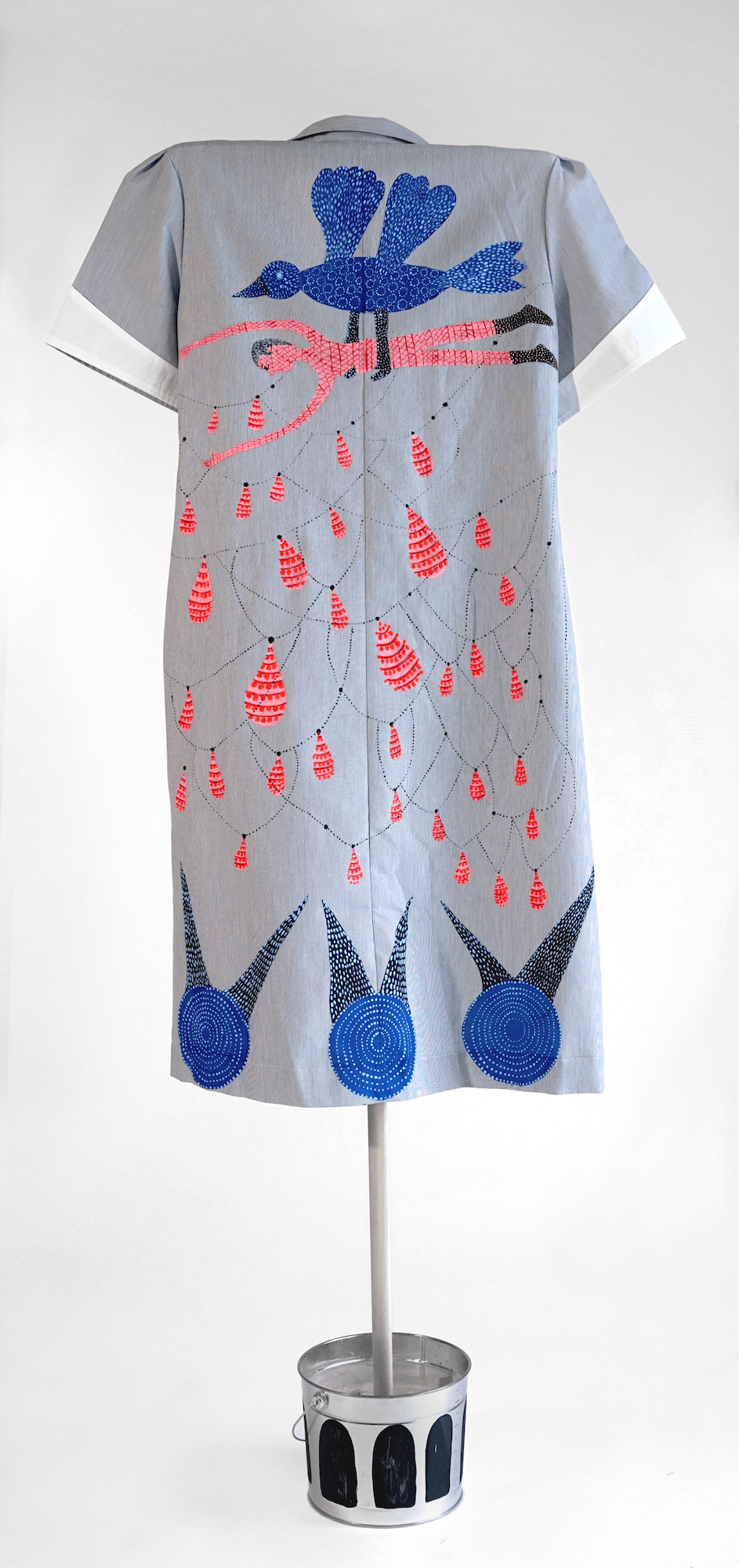"""""""Homesick,"""" from the Series Early Birds, 2019, Back (Domestic worker's uniform modified- hand painted on fabric)."""