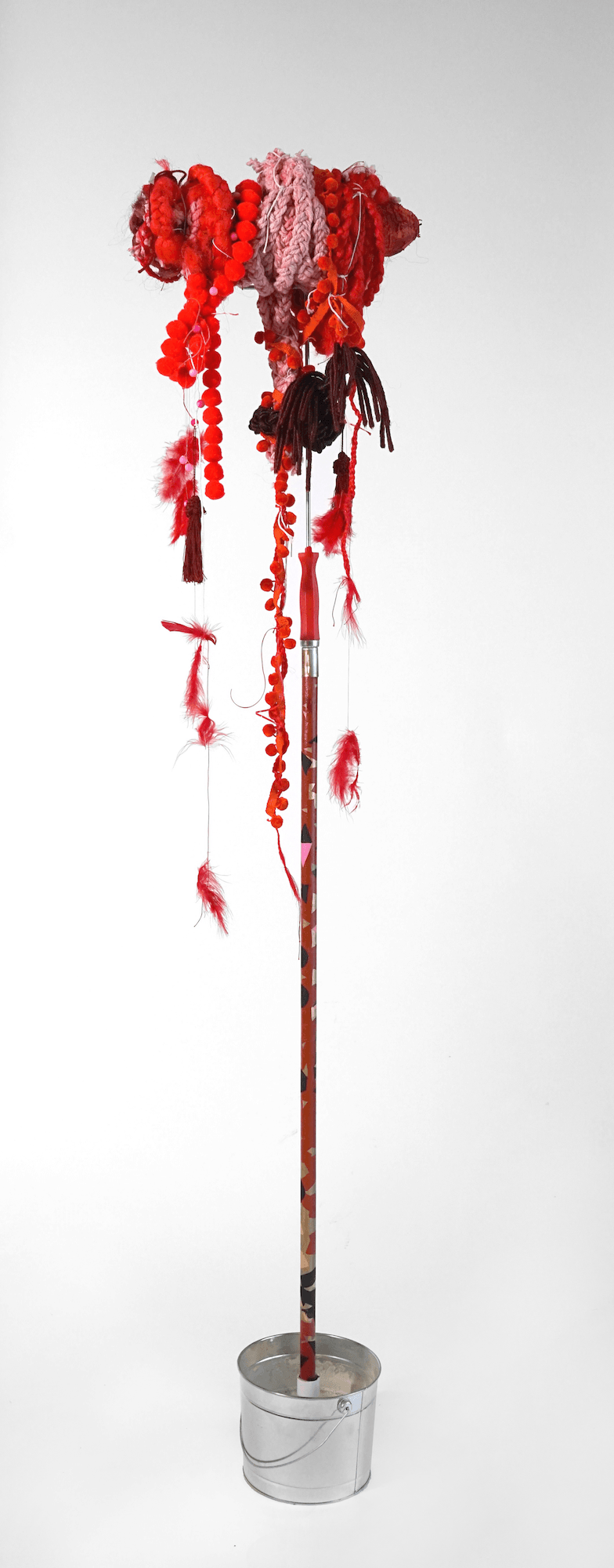 """""""Mop 3"""", from the Series Whips, Whims and Wigs, 2019, Transformed mop head into a hairdo on  decorated stick, various materials"""