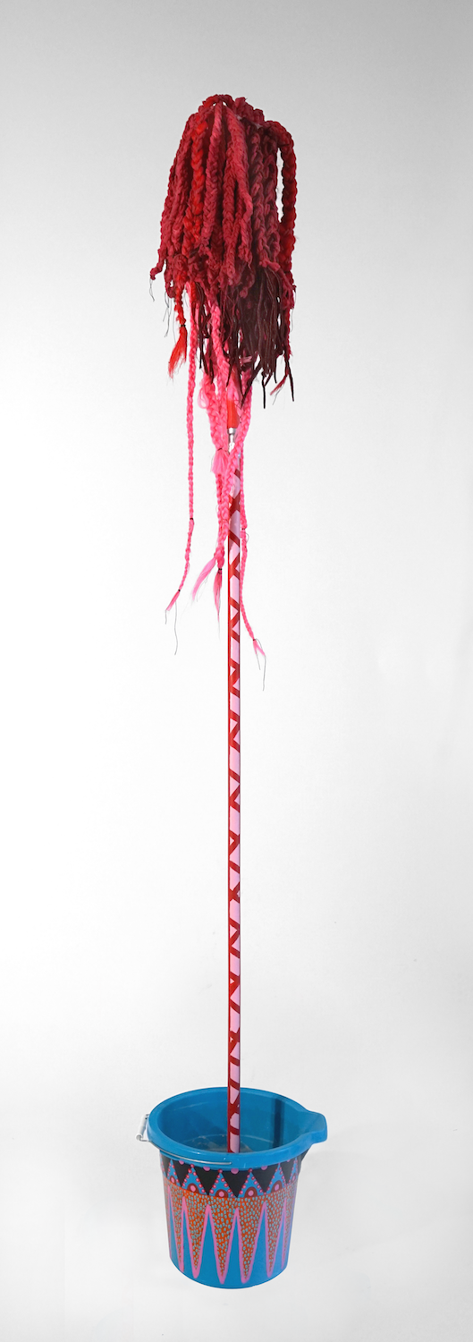 """""""Mop 2"""", from the Series Whips, Whims and Wigs, 2019, Transformed mop head into a hairdo on  decorated stick, various materials."""