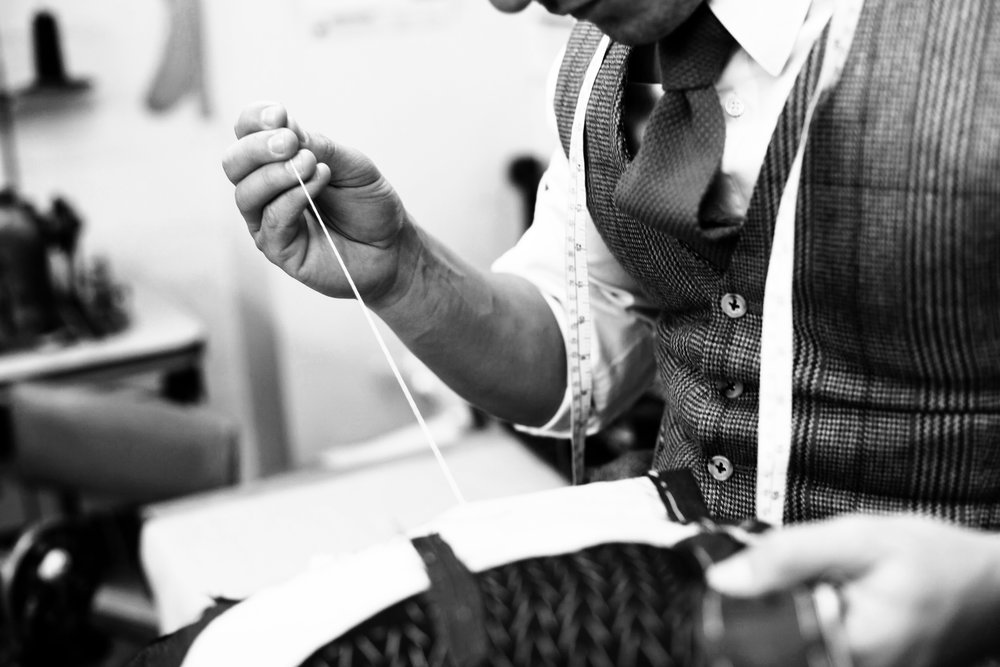 Close attention to detail and many hours of work go into each bespoke suit.