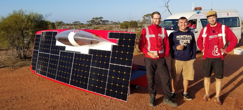 Levi Allery, center, traveled with student teams from around the world as they raced solar-powered cars across Australia's Outback during the 2017 World Solar Challenge on Oct. 8-15. Photo courtesy Levi Allery.