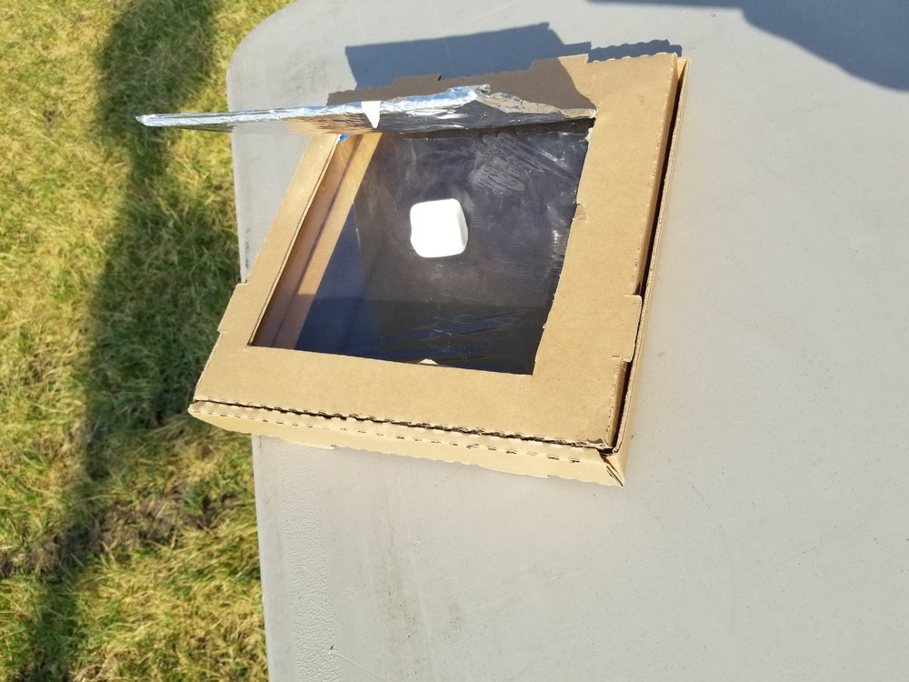 Kids were able to make these solar ovens to cook marshmallows and make S'mores.