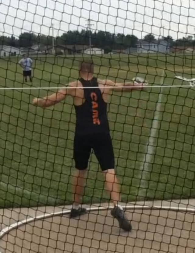 Justin setting the discus US record at the Meijer State Games of Michigan 2017. Courtesy of Justin Caine.