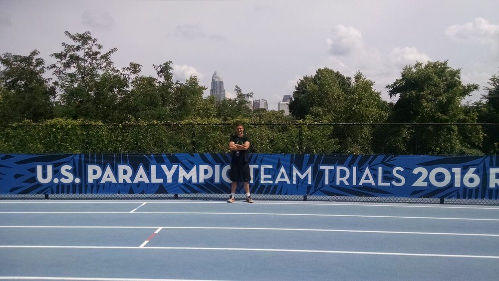 Justin stands for a picture at the U.S. Paralympic Team Trials in 2016 in Charlotte, North Carolina. Courtesy of Justin Caine.