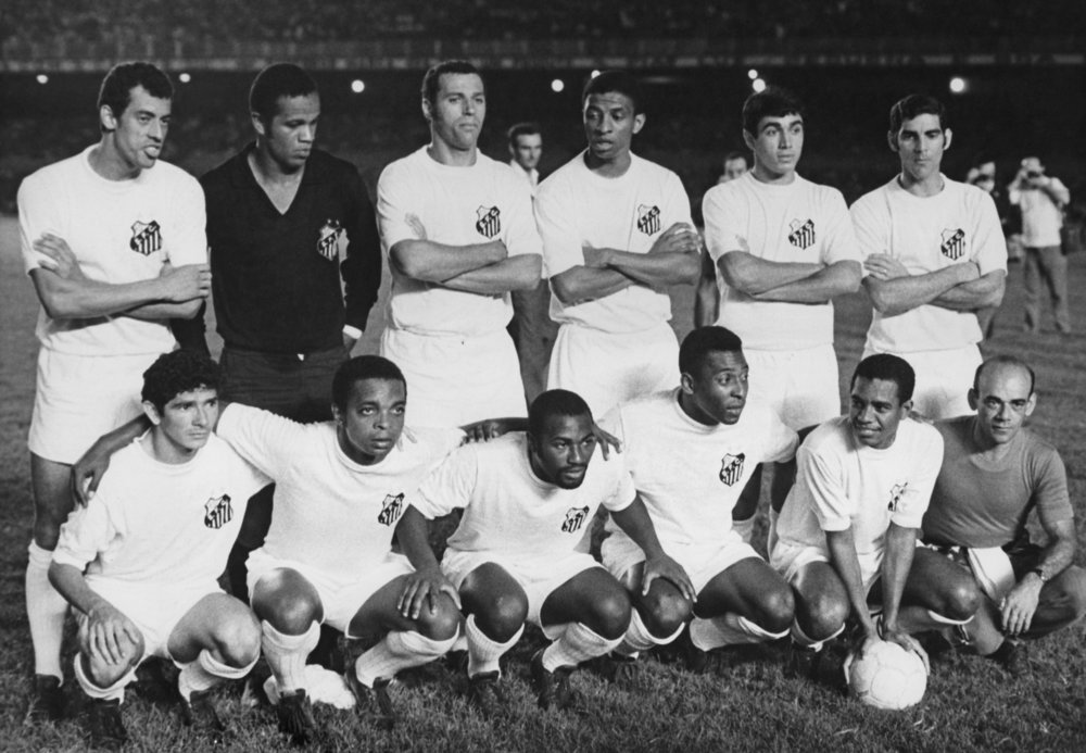 Pele and his Santos FC team mates pictured before their game against Vasco de Gama at the Maracana Stadium, Rio de Janeiro, Brazil, 19th November 1969. Santos were awarded a penalty during the match which Pele scored to reach the 1,000th goal of his career.  Photo by Pictorial Parade/Archive Photos/Getty Images.