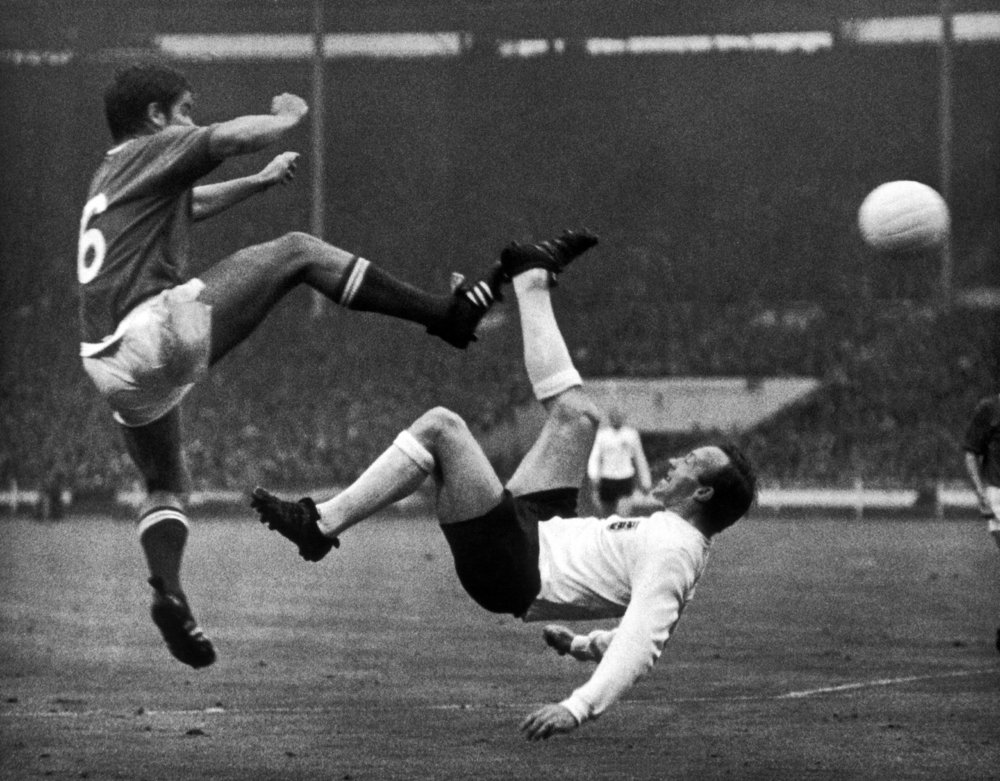 The British player Nobby Stiles (right) making an overhead flick with the ball shot by the French player Robert BudinskiI (left).  Photo by Keystone-France/Gamma-Keystone via Getty Images.