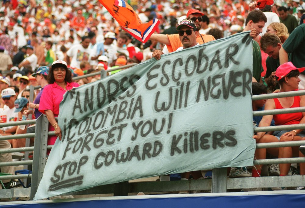 Fans at a 1994 World Cup match pay tribute to Andrés Escobar, Atlético Nacional's defender and captain, who had been murdered just two days before.  Photo by Shaun Botterill/ALLSPORT