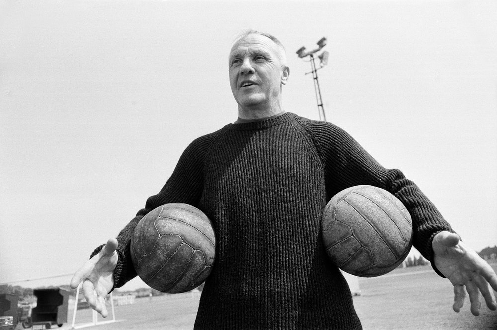 Bill Shankly practices his football skills at Liverpool FC's training ground in 1971.  Photo by Eddie Sanderson/Mirrorpix/Getty Images