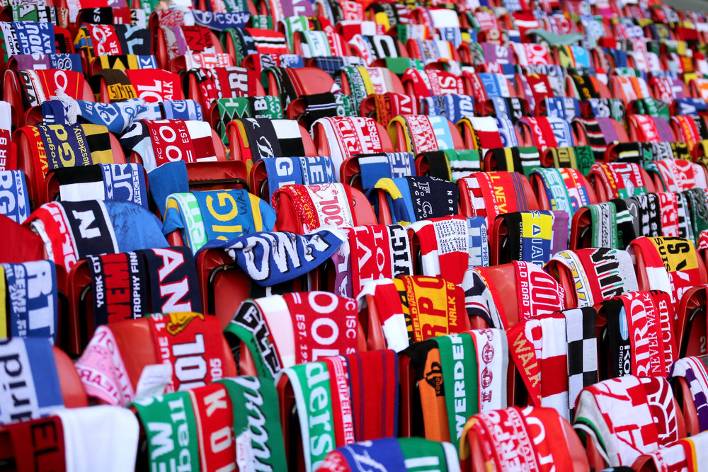 Football fans around the world donated scarves to be placed on empty seats at the Anfield Stadium to mark the 25th anniversary of the Hillsborough tragedy.  Photo by Christopher Furlong