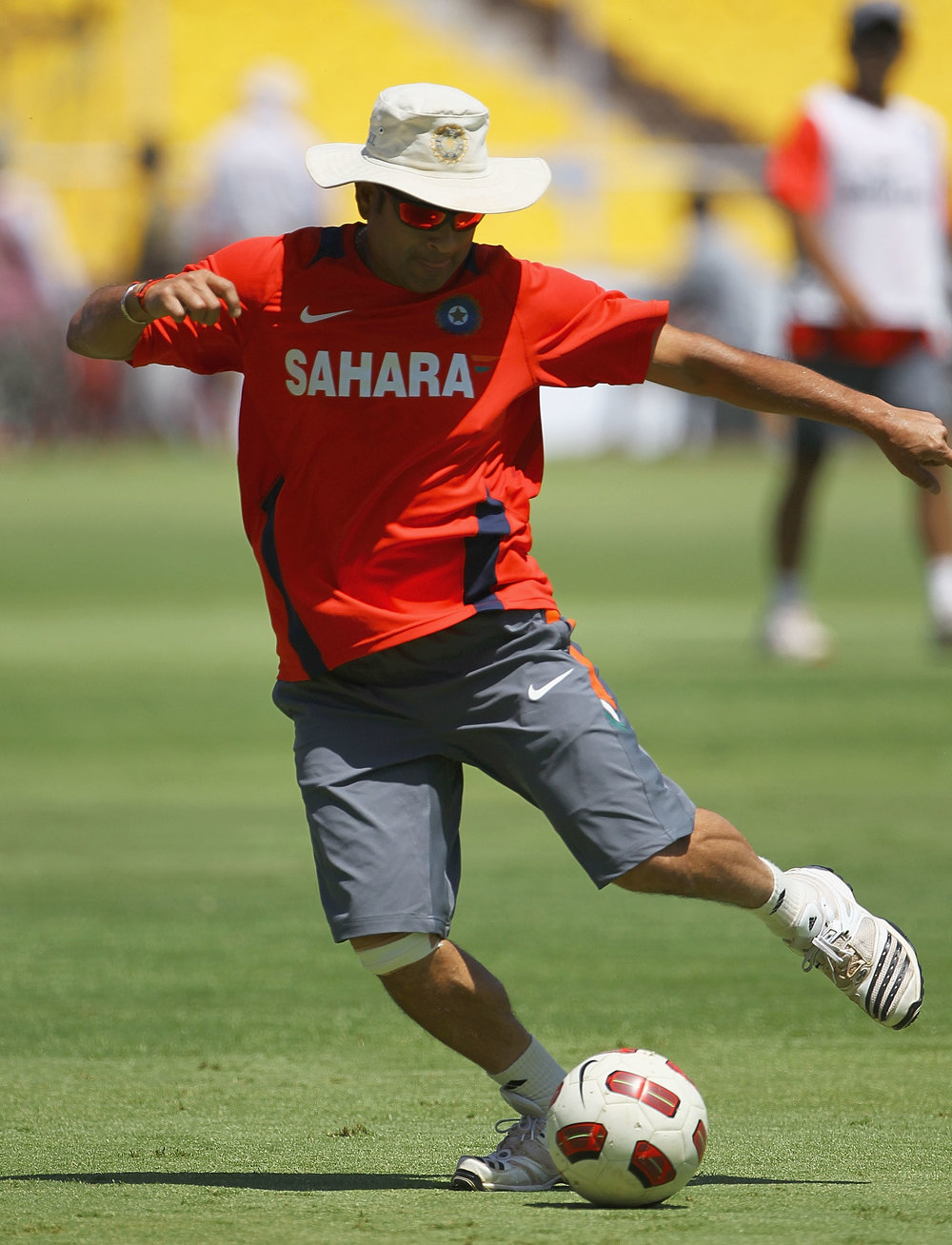 Sachin Tendulkar, former cricket captain and co-owner of the ISL's Kerala Blasters, plays football during an India Nets Session at the Sardar Patel Gujarat Stadium in March 2011.  Photo by Matthew Lewis/Getty Images