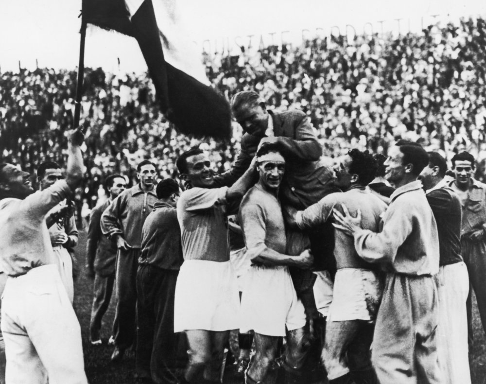 The 1934 Italian team carries their manager, Vittorio Pozzo, after beating Czechoslovakia in the World Cup final in Rome.  Photo by Keystone/Getty Images