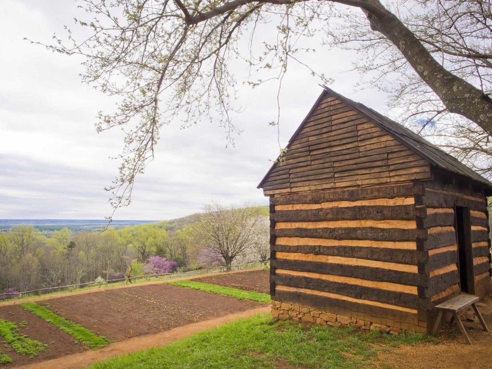 Slave cabin overlooking the gardens