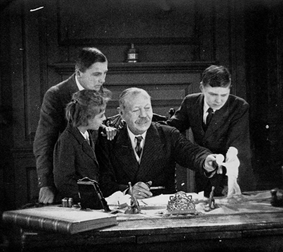 Arthur Conan Doyle at desk with children including Jean Conan Doyle