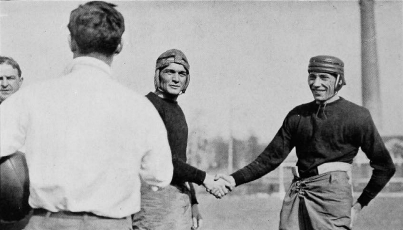 Captains from Miami (left) and Cincinnati (right) shake hands before the game in 1915. (UC Libraries)
