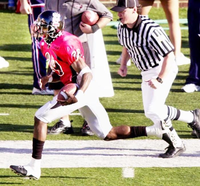 Zach Norton runs back an interception for a touchdown. (Jeff Swinger)
