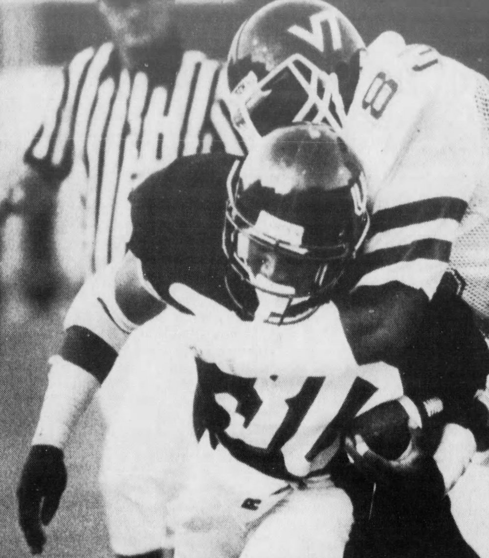 Cincinnati RB Reggie Taylor gets tackled by a VT defender. [Cincinnati Enquirer]