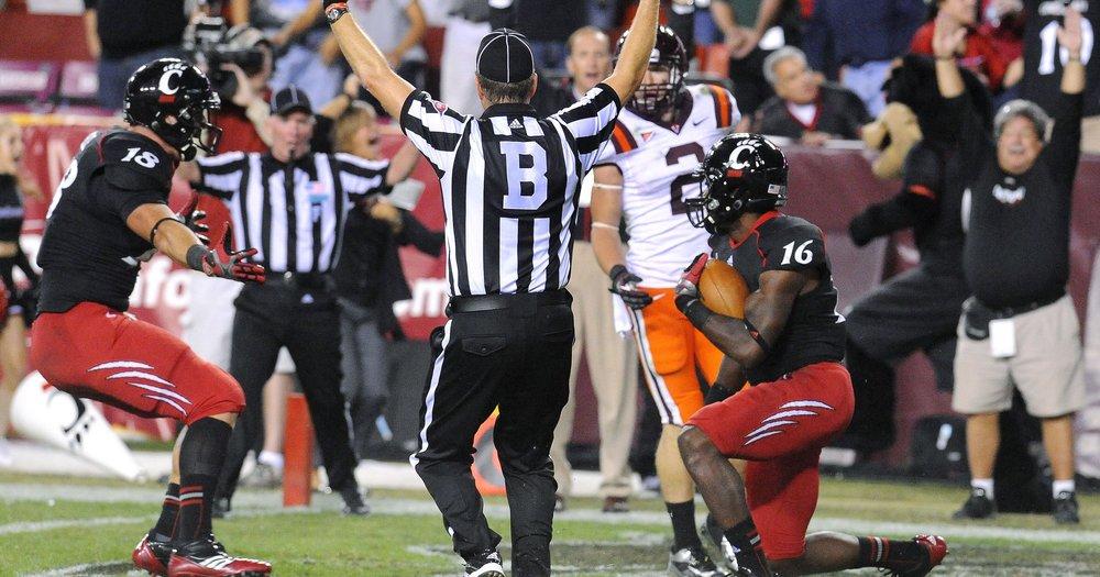 Travis Kelce (left) and Damon Julian celebrate the game-winning touchdown. [Photo: Richard Lipski / AP]
