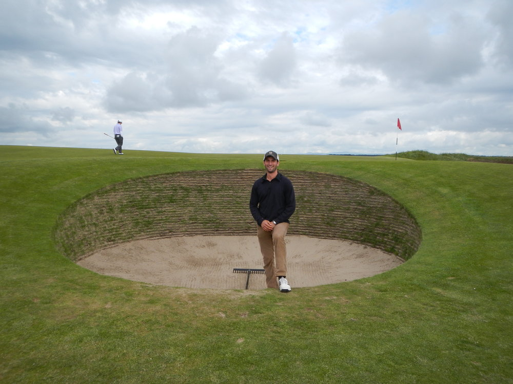 Jeffrey standing with the famous Strath bunker on the Old Course of St. Andrews.