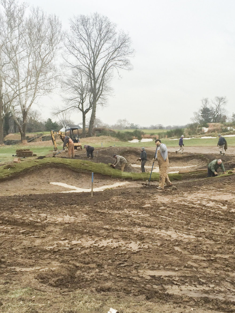 Crew members at the Merion Golf Club installing drainage.