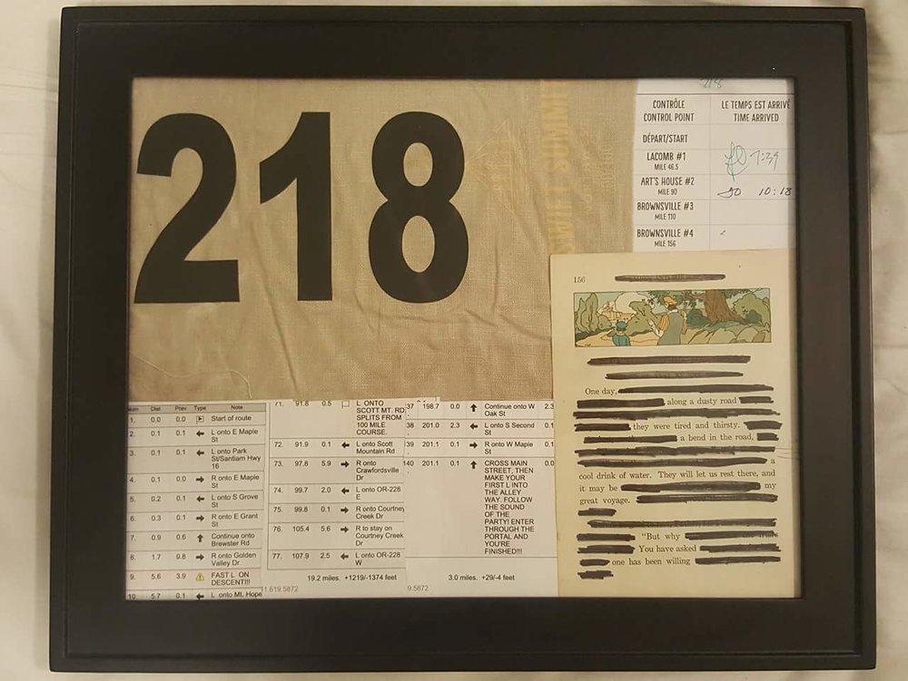 Framed blackout poem, cue cards, bib number, checkpoint card.