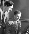 Benjamin Britten, at the piano, studying a score along side his partner and tenor, Peter Pears.