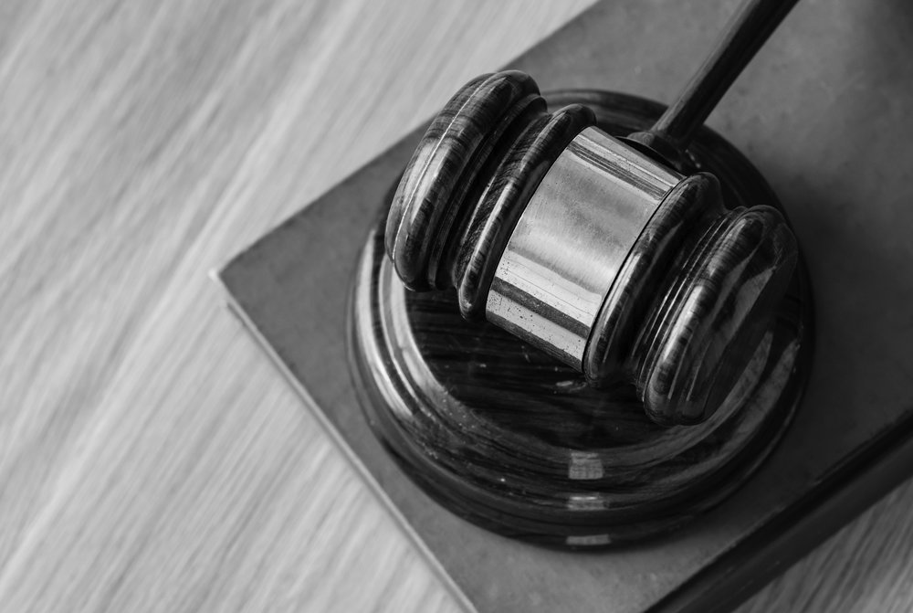 A gavel sits on a table.