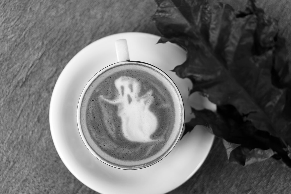 A ghost design in a latte, seen from above.