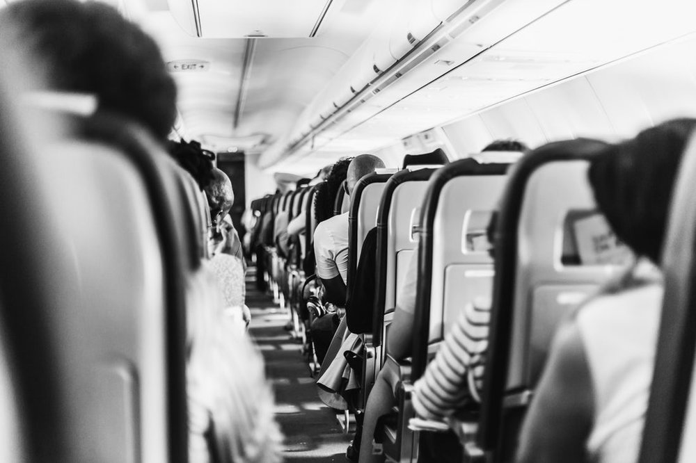 An airplane aisle looking forwards
