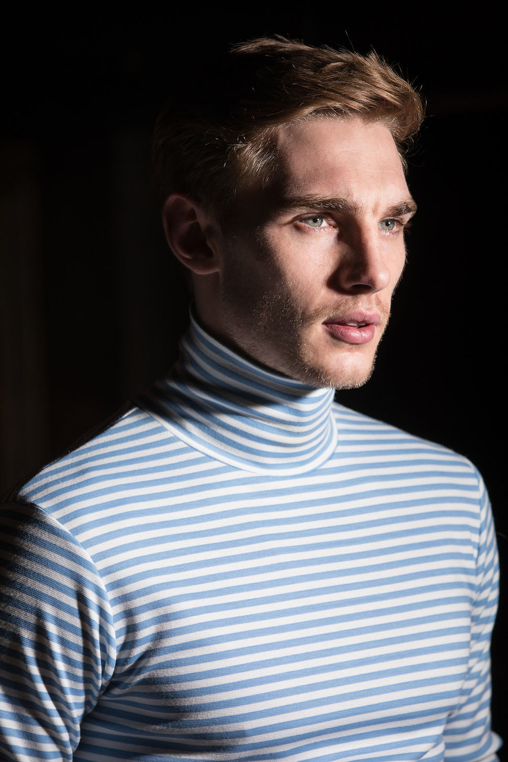 Tommy wears  Daniel w Fletcher  polo neck with  Basic Rights  trousers